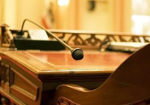 A microphone on the antique desk of a California State Senator. In the chambers of the California Senate in Sacramento.